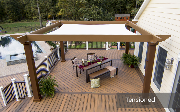 Trex Pergola Vision with Tension Canopy Covering Outdoor Dining Area