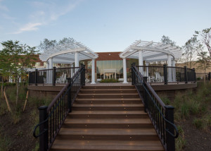 Curved Trex Pergolas on Outdoor Deck at Hospital