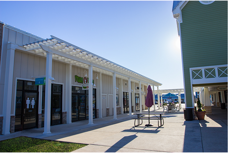 Trex Pergolas at Tanger Outlets with ShadeRight Fixed Canopy over Restrooms