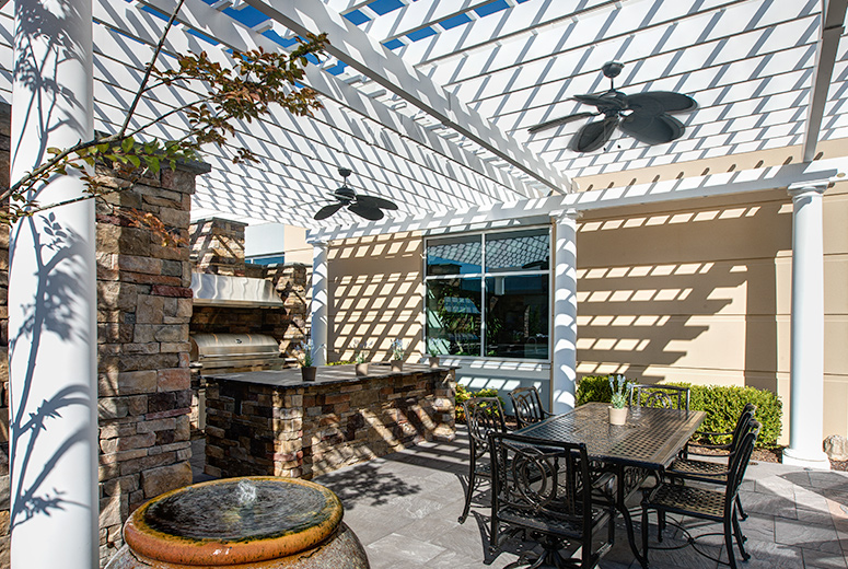 Trex Pergola Over Outdoor Showroom with Integrated Fans and Full Kitchen
